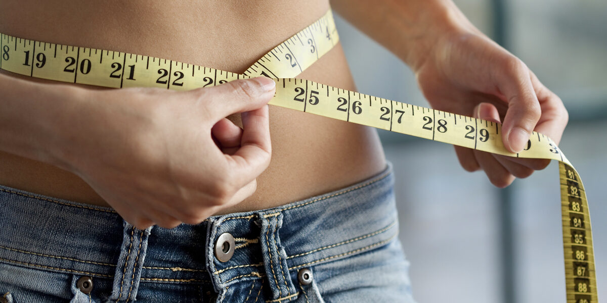 """""""Young, slim woman measuring her waist.  You may also like:"""""""